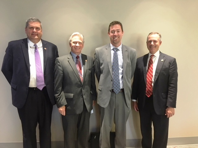 Dr. Ryan Squier center right meets with members of the HOPES Task Force left to right Reps. Scott Ryan Stephen Hambley and Robert Sprague